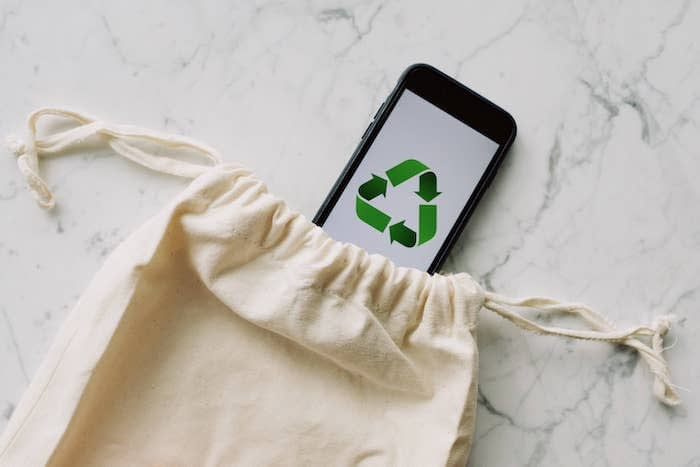 Fabric bag and phone with the recycling symbol