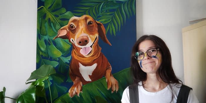 Artist Patricia Patto Galbani in front on a painting of her dog