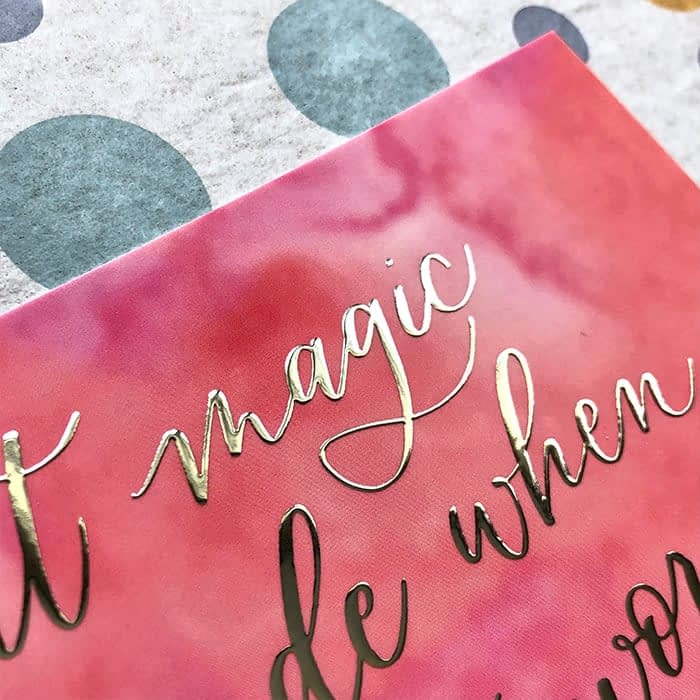 Detail of a silver foil lettering by Bright Spot Papier on a pink postcard