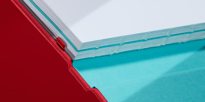 Red hardback journal with cloth cover and swiss binding